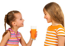 Happy kids drinking juice Stock Images