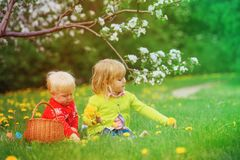Happy kids on easter eggs hunt in spring. Nature Royalty Free Stock Photo