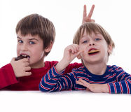 Happy kids eating cookies Royalty Free Stock Photos