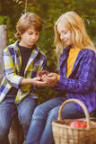 Happy kids eating fruits from picnic basket Stock Photography