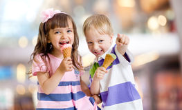 Happy kids eating ice cream on nice bokeh Stock Image