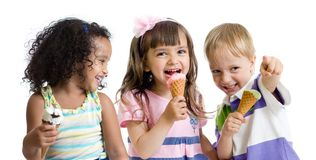Happy kids eating ice cream in studio isolated. On white royalty free stock photo