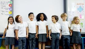 Happy kids at elementary school stock images