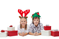 Happy kids with elf and reindeer hats Royalty Free Stock Image