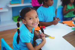 Happy kids enjoying arts and crafts painting Stock Photography