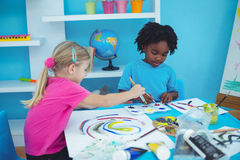 Happy kids enjoying arts and crafts painting stock photos