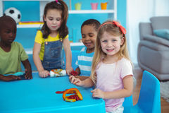 Happy kids enjoying arts and crafts together Stock Photography