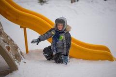 Happy kids enjoying riding on sledge Royalty Free Stock Photo