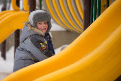 Happy kids enjoying riding on sledge Stock Images