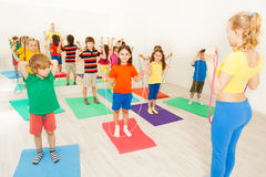 Happy kids exercising with jumping rope in gym Royalty Free Stock Photography