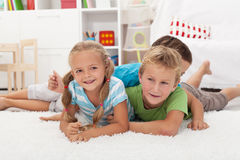 Happy kids on the floor Stock Photo