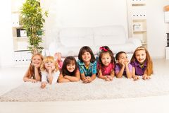 Happy kids on the floor Stock Photos