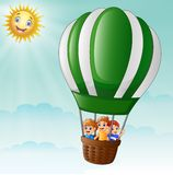 Happy kids flying in a hot air balloon Royalty Free Stock Photography
