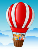 Happy kids flying in a hot air balloon Royalty Free Stock Images