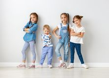 Happy kids friends around empty walls royalty free stock images