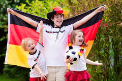Happy kids, German football supporters stock image