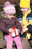 Happy kids with gift Royalty Free Stock Image