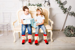 Happy  kids with gift box in the living room at Royalty Free Stock Image