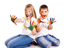 Happy kids with hands painted in colorful paints Royalty Free Stock Photography