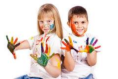 Happy kids with hands painted in colorful paints Stock Photography
