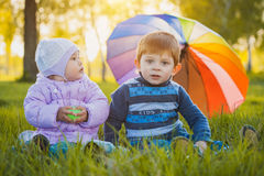 Happy kids have fun in outdoors park Stock Photo