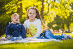 Happy kids have fun in outdoors park Stock Photos