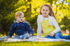 Happy kids have fun in outdoors park Royalty Free Stock Photo