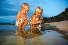 Happy kids have a fun on sunset beach royalty free stock photography