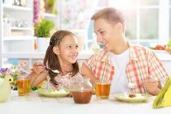 Happy  kids having breakfast Royalty Free Stock Image