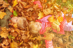 Happy kids having fun in autumn fall leaves Royalty Free Stock Images