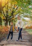 Happy kids having fun in autumn park Royalty Free Stock Photos