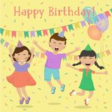 Happy kids having fun on the background of festive decorations. Happy kids smiling and having fun on the background of festive decorations. Girls and boy Royalty Free Stock Photography