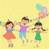 Happy kids having fun on the background of festive decorations. Happy kids smiling and having fun on the background of festive decorations. Girls and boy Stock Image