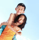 Happy kids having fun doing piggyback ride Royalty Free Stock Photos