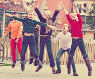 Happy kids having fun and jumping up. Happy  positive kids having fun and jumping up Stock Photo