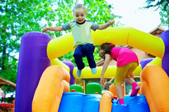 Happy kids having fun on playground Stock Images