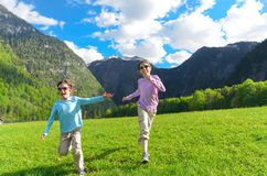Happy kids having fun and running outdoors Stock Images