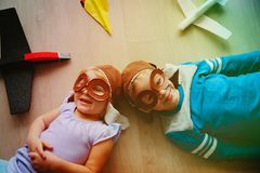 Happy kids with helmet and glasses play with toy planes. Kids imagination Royalty Free Stock Image