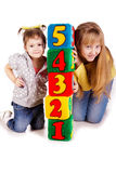 Happy kids holding blocks with numbers. Over white background Stock Photos