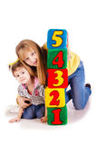 Happy kids holding blocks with numbers. Over white background Stock Photography