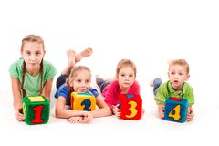 Happy kids holding blocks with numbers over white background Royalty Free Stock Photo