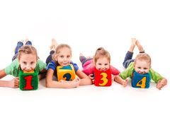 Happy kids holding blocks with numbers over white background Royalty Free Stock Photography