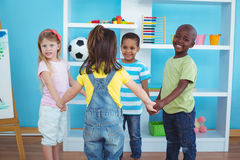 Happy kids holding hands together Stock Photos