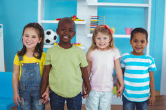 Happy kids holding hands together Stock Photo