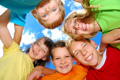 Happy Kids in a Huddle Stock Image