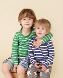 Happy Kids Hugging and Smiling. Two happy kids, children hugging, smiling and laughing Stock Photography