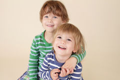 Happy Kids Hugging and Smiling. Two happy kids, children hugging, smiling and laughing Stock Photos