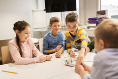 Happy kids with invention kit at robotics school. Education, children, technology, science and people concept - group of happy kids with invention kit at Stock Photos