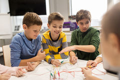 Happy kids with invention kit at robotics school. Education, children, technology, science and people concept - group of happy kids with invention kit at Stock Image