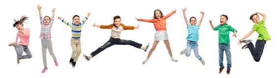 Happy kids jumping in air over white background royalty free stock photography